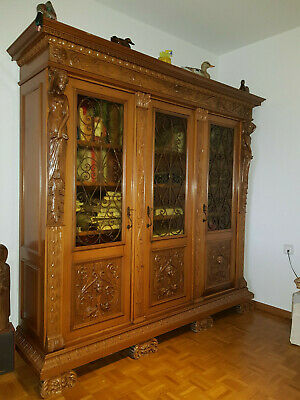 Cabinet (bookcase) in hand carved walnut