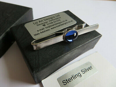 Sterling silver hand crafted tie clip with blue glass cabouchon boxed