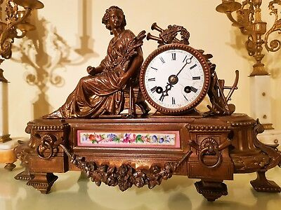 Antique French Bronzed Metal Figural Mantel Clock with Sevres Panel.