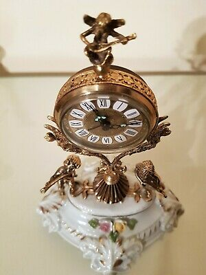 A French Style German Ceramic & Gilt Mantel Clock with Alarm.