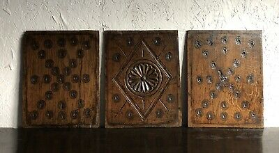 A Set Of Three 17th Century Carved Oak Welsh Panels with Bulls eye design.