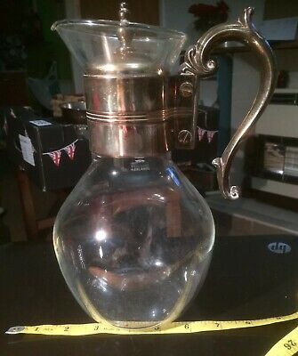 vintage claret jug . 9 & 3/4 inches high and with original insert lid.