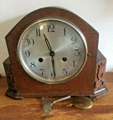 haller mantle clock. working. 8 & 3/4 inches high. carved decor