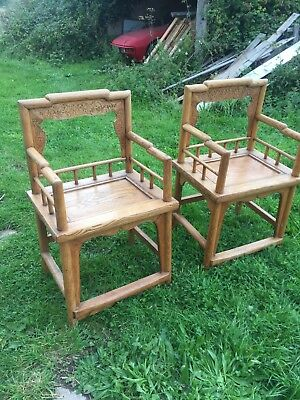 Pair of antique carved Chinese elm marriage chairs