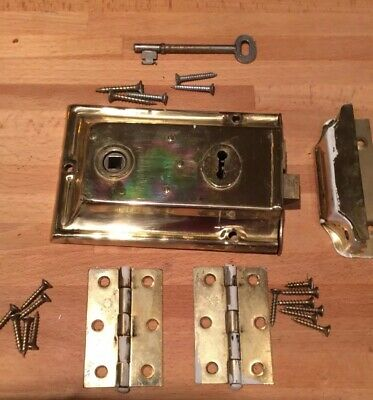 Old Brass Lock/Latch Set. With key Plus 5 Brass Hinges . No Actual Knob .