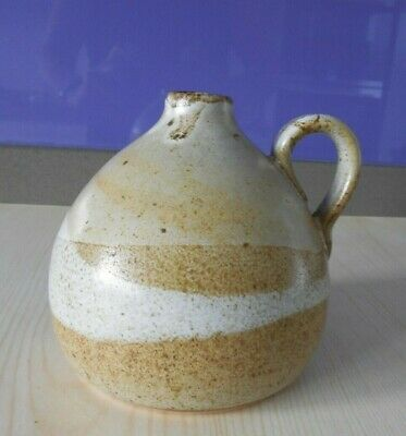 Small ceramic pot with handle