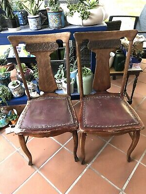 2 Carved Antique Oak Dining Chairs Pressed leather Seat