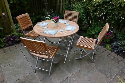 Luxury John Lewis solid Teak and Steel garden furniture - table and four chairs