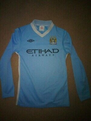 Umbro Manchester City Home Shirt Size MB Aged 9/11. Long Sleeve.
