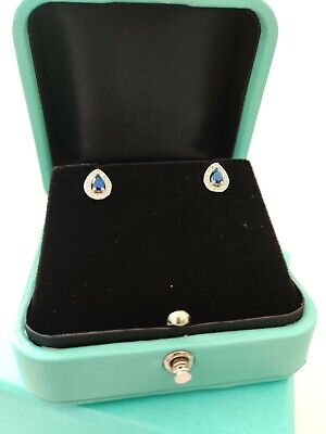 White gold finish blue sapphire created diamond pearcut earrings