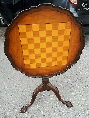 Antique  chess table , with claw feet , tilt top