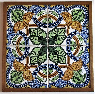 Framed panel of four hand painted Spanish majolica tiles in 16th century style