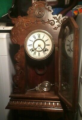 ansonia gingerbread clock working with key, pendulum and glass