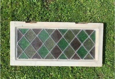 Georgian stained glass awning window in original wooden window frame