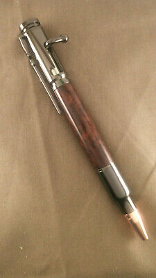 Bolt Action Bullet Pen, with Jarah Burl centre piece, and Gun Metal trim!