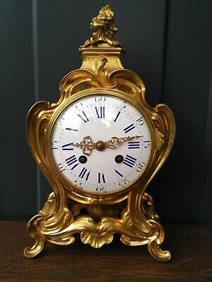 Antique bronze table cartelclock, fire gilt table clock with large movement