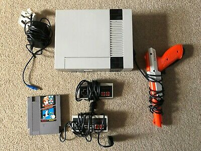 Original Nintendo NES Console with 2 pads , zapper and 2 games- tested working