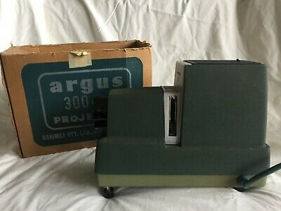 Vintage Argus 300 Watt Slide projector + magazines + lighted slide viewer