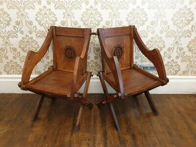 A Pair of Late Victorian Glastonbury Oak Armchairs