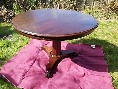 Victorian Round  wooden Table with carved feet. 108cm wide