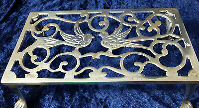 Antique fret-work brass trivet stand / footman with bird detail & claw feet