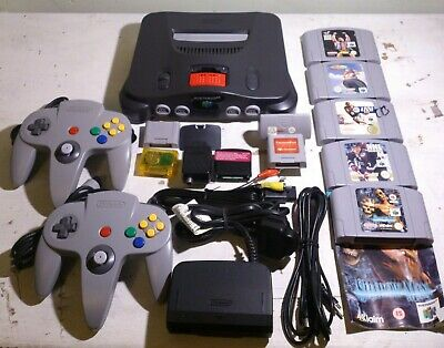 Nintendo 64 BUNDLE WITH OFFICIAL MEMORY EXPANSION  2 CONTROLLERS AND GAMES