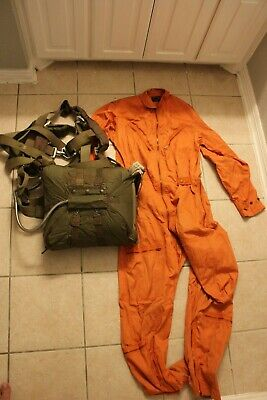 Post WW2 U.S. complete seat parachute harness with flight suit. Named