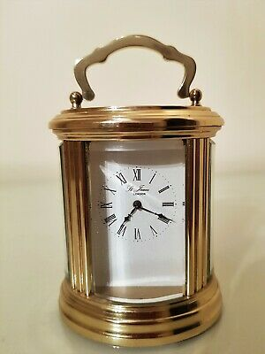 French Gilt Brass Oval Carriage Clock.