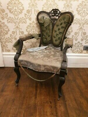An Edwardian Ebonised Salon Chair On Castors, for re-upholstery