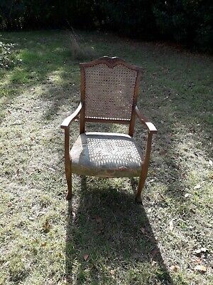 Antique carved bergere chair with cane back