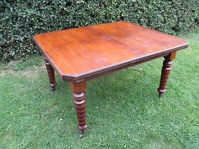 Late Victorian Mahogany Wind Out Dinning Table on Brass Castors
