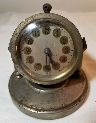 SMALL ANTIQUE BRASS DESK CLOCK SPINS ON BASE INTERESTING DESIGN FROM EARLY 1900s