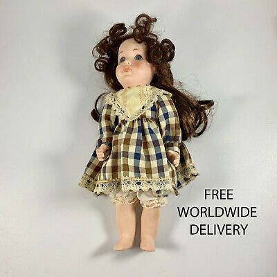 4480 Forty year old Vintage collectors doll with porcelain face, hands and legs