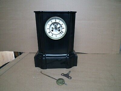 Beautiful black slate/marble French clock with open escapement