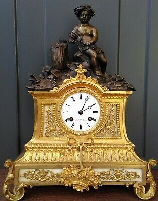 Antique French bronze and fire gilt bronze mantelclock - Bacchant - grapes