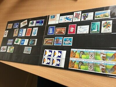 UNO and Australia nhm stamp assortment on pages