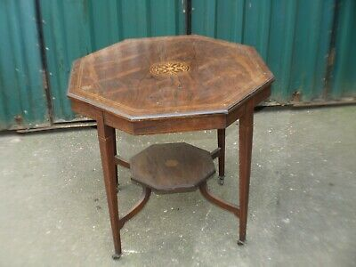 Inlaid Edwardian octagonal occasional table with shelf under on original casters