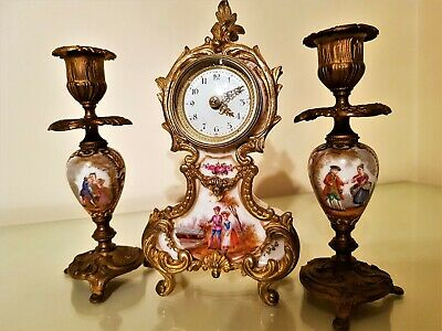 Antique French Gilt and Porcelain Mantel Clock Garniture.