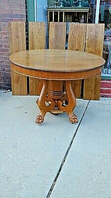Victorian Antique Quarter sawn Oak Round dinning Table with claw feet & 5 leaves