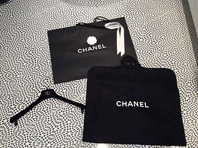 Chanel cloths protector, hanger and shopping bag