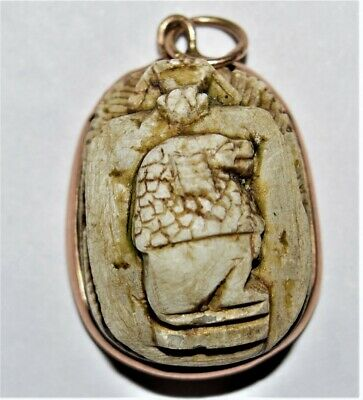 Carved beige limestone scarab, the ancient Egyptian around Gold,