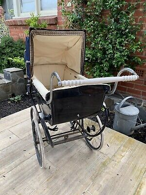 Vintage Silver Cross Pram with hubcaps