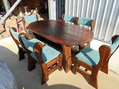 VERY RARE VINTAGE 1970's RETRO 7 PIECE HEAVY SOLID WOODEN TABLE AND CHAIRS.