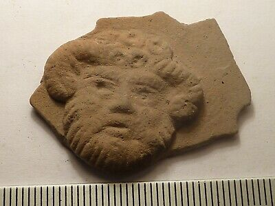 5985	Ancient Roman terracotta pot fragment image of satyr