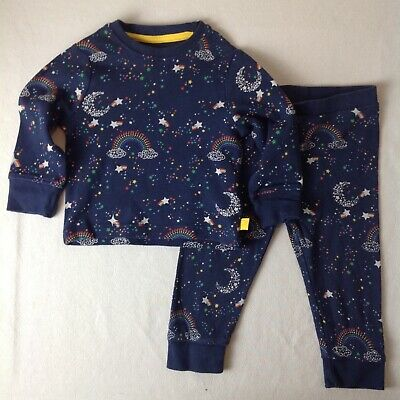 Baby pyjama set with clouds stars & rainbows from Little Bird in 9 to 12 months