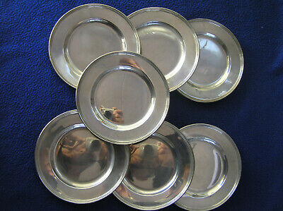 Seven sterling silver bread and butter plates by International 522 g