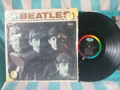 """Beatles L.P. """"Meet The Beatles"""" album.. Third label ..Cover with Sears baggie"""