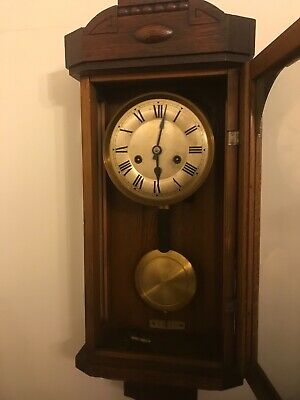 antique oak cased wall clock working
