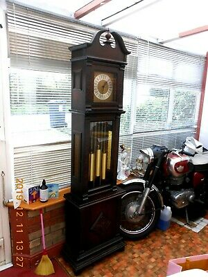 Beautiful chiming grand father clock recently serviced.