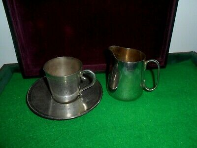 marked EPNS Metal Milk Pitcher,metal cup with saucers marked MENESES